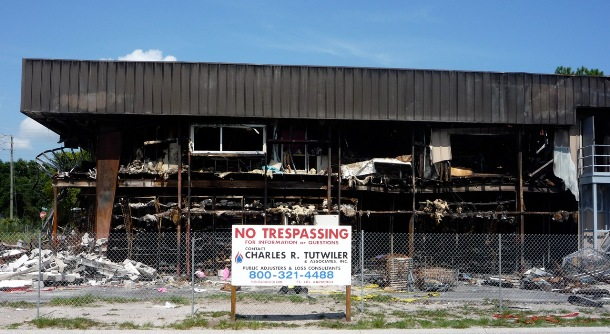 warehouse building damaged by fire and smoke